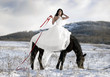 Bride with a horse in the snow