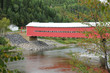 Quebec, a red covered bridge on Matapedia river in Gaspesie