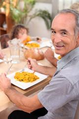 Family eating paella