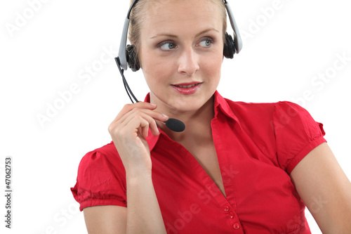 Blond receptionist using telephone head-set