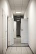 corridor with many doors open
