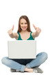 Woman with laptop showing thumbs up