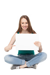 Young woman sitting with blank poster