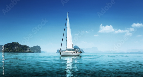 yacht and blue water ocean - 47063348