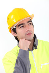 A pensive manual worker.
