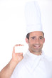 Chef with a blank business card