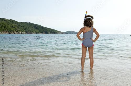 portrait of little girl in the sea