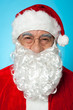 Snapshot of smiling senior man in Santa attire
