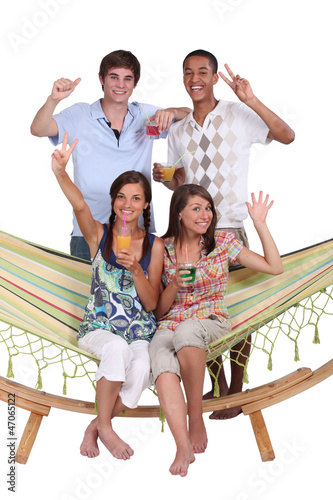 Young friends around a hammock