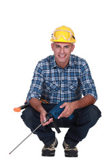 Workman with a masonry drill