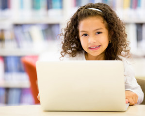 Little girl using  a computer