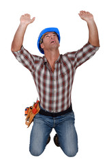 Builder holding up invisible object