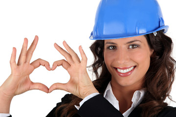 Businesswoman  making heart shape