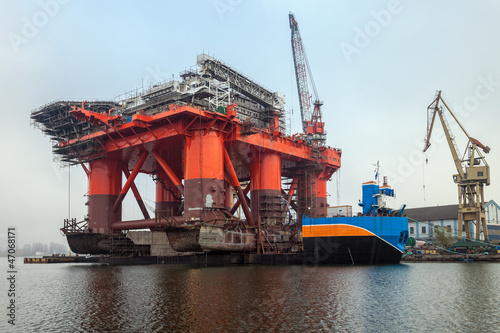 12 000 ton Oil Rig was pulled from the water on a special barge