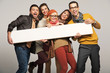Leinwanddruck Bild - Smiling people with empty board