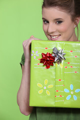 Woman holding a big wrapped package.