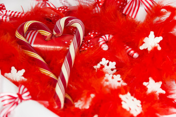 Christmas candy on a bed of red feather.