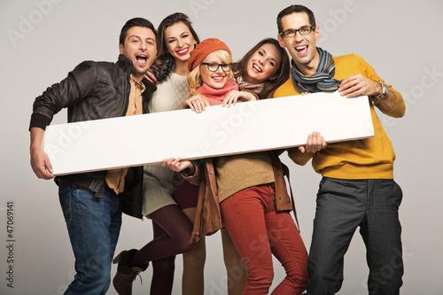 Leinwanddruck Bild Smiling people with empty board