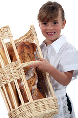 little girl dressed as a baker carrying bread in a basket