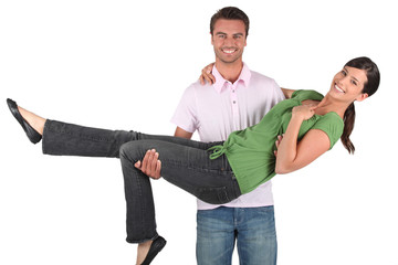 Man carrying woman