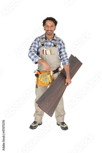 Woodworker pointing to laminate flooring