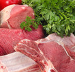 assortment of raw meat with vegetables