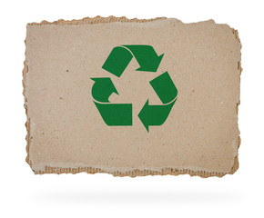 Recycle sign on a piece of cardboard.
