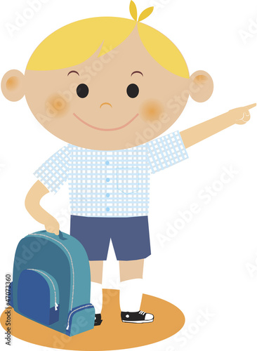 boy pointing while holding his backpack