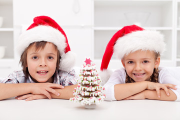 Kids at christmas time with gingerbread tree