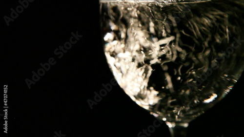 HD Video : Mineral water pours into Transparent wine glass