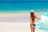 beautiful woman in a bikini and pareo on tropical beach poster