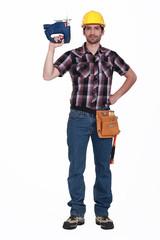 Carpenter holding chainsaw