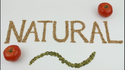 Natural written with wheat kernels