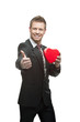 young cheerful businessman holding red heart