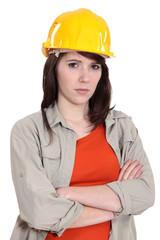 Woman with yellow helmet