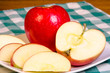 Red apple sliced on plate