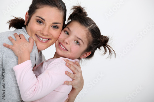 Mother hugging her daughter