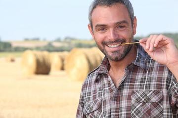 Farmer chewing a straw