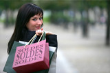 Young woman carrying her shopping bags