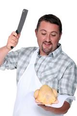 Butcher cutting chicken