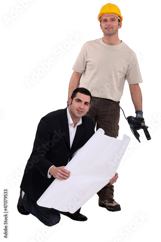 craftsman and businessman posing together