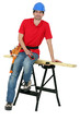 Carpenter sitting on a workbench