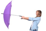 Young woman struggling with a purple umbrella on a windy day