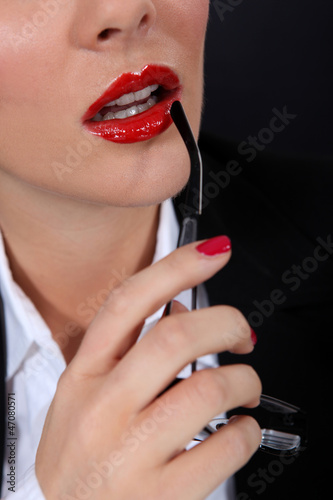 Sexy woman with red glossy lipstick