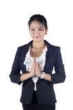 Thai business women in a traditional welcoming gesture