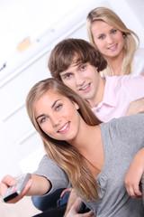 Three teenager sat at home