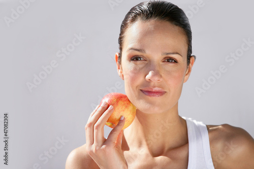 Woman with apple in hand