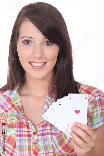 Girl showing playing cards