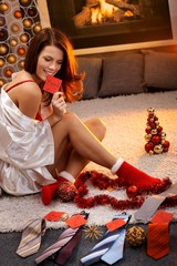 Sexy woman arranging christmas gifts