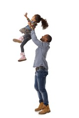 Father throwing little daughter in the air